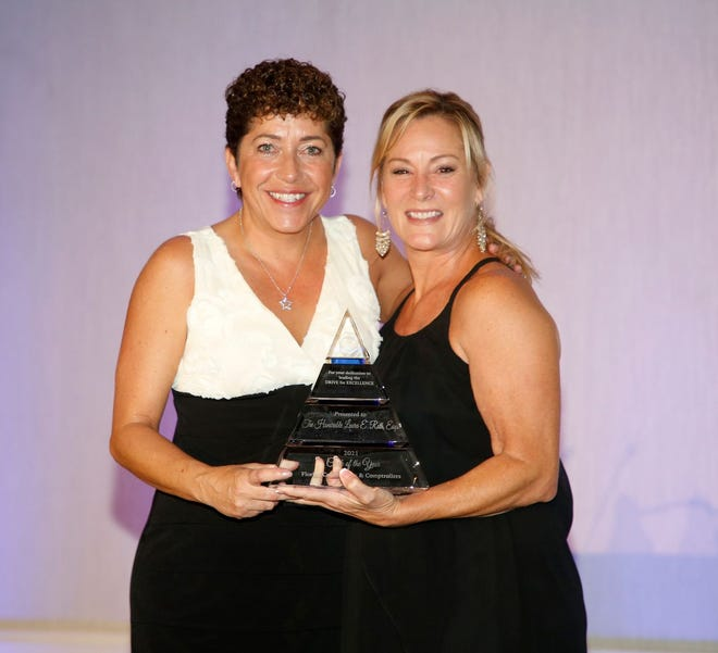 Volusia County Clerk of Courts Laura Roth (left) is presented the award for Florida Court Clerks and Comptrollers Clerk of the Year for 2021. Roth received the award last month. Roth is presented the award by Tara Green, the Clay County Clerk of Courts, who is also the outgoing president of the FCCC .
