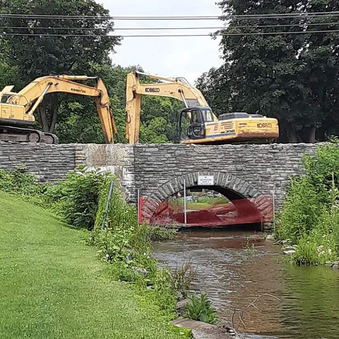 Demolition work has begun to remove a stone masonry arch culvert on Route 20 in West Winfield.