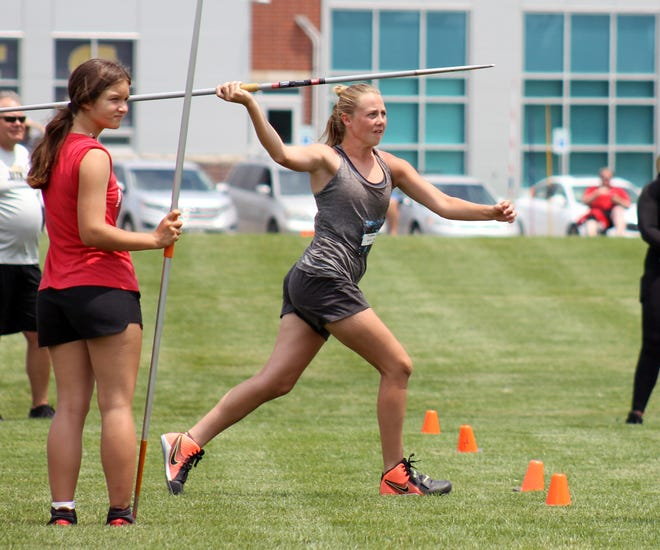 Grain Valley High School's McKenah Sears, center, works on her javelin throwing at the Midwest Elite Throws Camp put on by William Chrisman track and field head coach Tyler Rathke at Liberty North High School. Sears earned a state medal in the javelin as a freshman