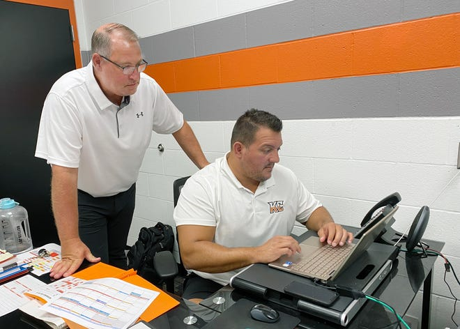 Mike Cukyne, the new Kansas City Mavericks president, left, looks over some roster details with head coach and general manager Tad O'Had this week at Cable Dahmer Arena. Cukyne comes to the Mavericks after four years as a Chiefs vice president. [Bill Althaus/The Examiner]