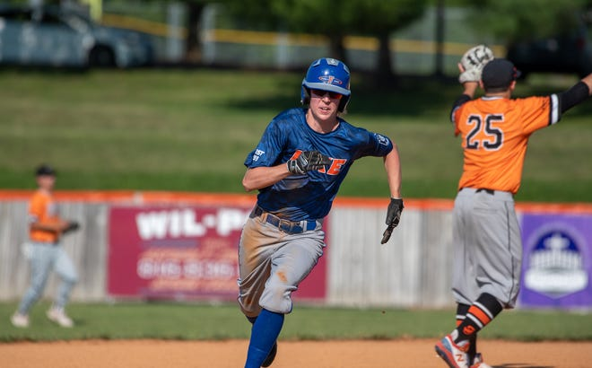 Blue Springs Post 499 Fike's Hunter Hughes, center, races toward third base on a teammate's hit in Thursday's game against Omaha Post 311 South in the American Legion Wood Bat Invitational at Hidden Valley Park. Fike led 2-0 early but fell 6-2.