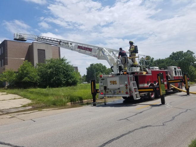 A Burlington Fire Department firetruck works on the fire at the old Klein Center on the 2900 Block of Madison Avenue. The Fire Department was paged to the scene sometime after 1:30 p.m. on Friday, July 9, 2021.