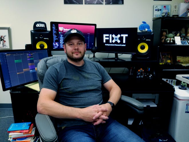 James Rhodes, vice president and co-founder of FiXT, poses in his Burlington office last week. The global record label is celebrating 15 years of success with a special event at noon Tuesday.