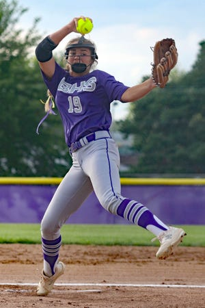Burlington Grayhounds' Saydee Plummer in her windup while pitching against the Fort Madison Bloodhounds in the class 4A regional quarterfinal Thursday at Wagner Field in Burlington