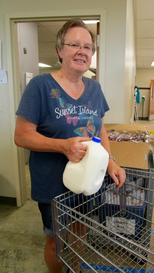 """Diane Cessna has been named """"Volunteer of the Month"""" for June at the Geneseo-Atkinson Food Pantry, where she has volunteered for the last five years. She distributes food and restocks shelves. Cessna said the best thing about volunteering at the Food Pantry """"is that it's always fun,"""" and she likes helping the community. Her most memorable experience at the Food Pantry happened recently when there was sewer backup and the building flooded."""