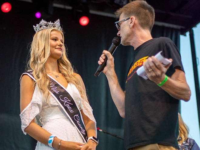 Miss Knox County Fair 2021 Taylor Main from Oneida speaks with FM-95 radio personality Eric Hanson during the Roots and Boots Tour concert on July 8 in Knoxville.