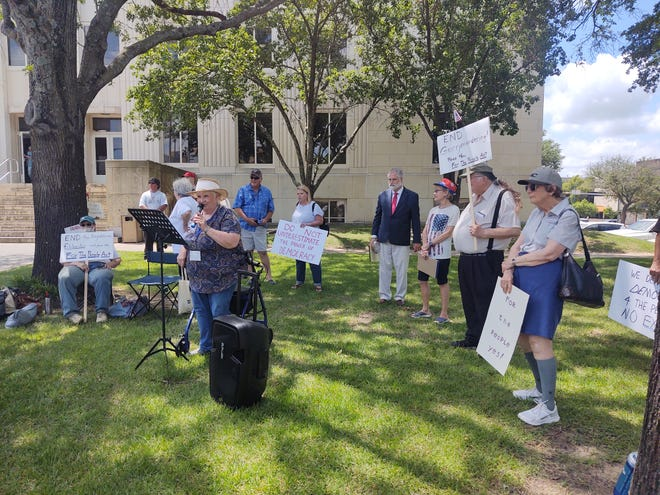 Jan Fletcher speaks Friday during a rally outside the Grayson County Courthouse in of Senate Bill 1, also known as the For the People Act. The bill includes voting reforms including changes aimed at reducing barriers to voting.