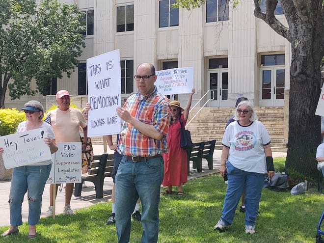 Grayson County residents gather outside of the Grayson County Courthouse Friday in support of Senate Bill 1, also known as the For the People Act. The bill includes voting reforms including changes aimed at reducing barriers to voting.