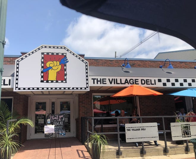 The Village Deli on Kirkwood Avenue reopened in July after flooding damage was repaired.