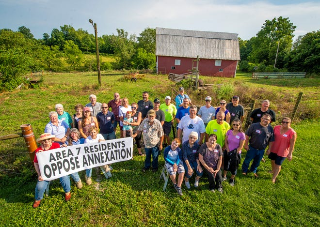A group of Area 7 residents pose July 8 near the corner of West Bayles Road and North Kinser Pike.