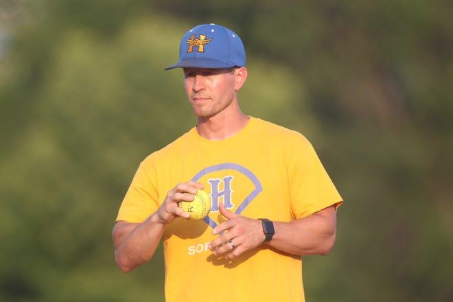 Hutchinson High head softball coach Clayton Evans prepares a pitch during a coach-pitch kids' softball game at the Fun Valley Sports Complex.