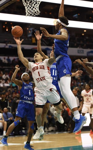 Winston-Salem State's Robert Colon drives to the basket between three Fayetteville State players in the Rams' 63-62 win over Fayetteville State in the championship game of the CIAA men's basketball tournament in 2020. [Walt Unks / Winston-Salem Journal]