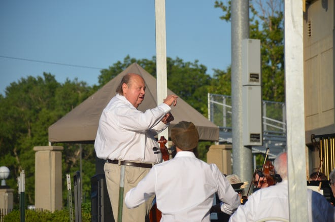 Keith Woolery directed the Newton Mid Kansas Symphony Orchestra to start the orchestra's concert at the Sand Creek Summer Daze in Athletic Park July 8.