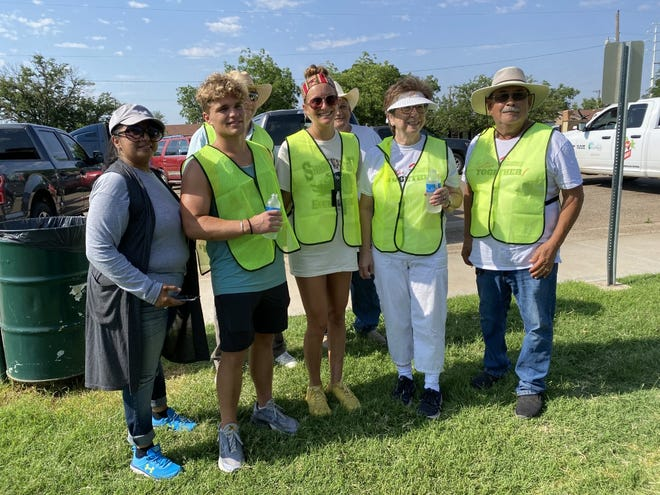 Members and volunteers from the North Lubbock Neighborhood Association  gathered in the Arnett Benson neighborhood to participate in a cleanup of the area.