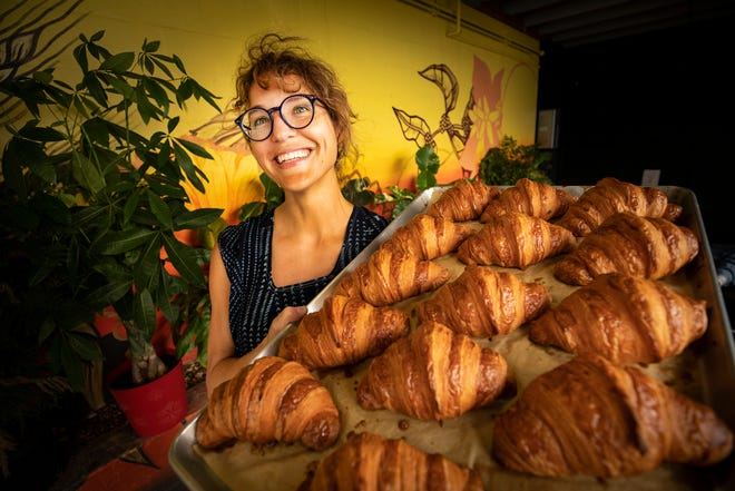 """Born & Bread Bakehouse founder Jennifer Smurr holds a tray of croissants at her bakery on South Florida Avenue in Lakeland. Smurr was recently named to Forbes mazagine's list of """"Next 1,000"""" for innovative businesses and entrepreneurs."""