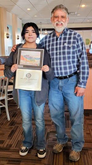 Anella Navarro, winner of the Congressional Art Competition for Colorado House District 4, and her Swink High School Art teacher Max Cordova.