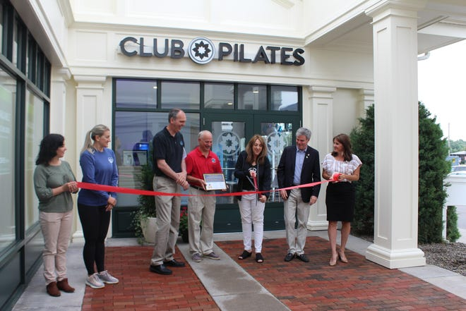 Perinton Town Supervisor Ciaran Hanna; Town Board members David Belaskas, Seana Sartori, Meredith Stockman-Broadbent and Alexandra Winner; and Monroe County Legislator John Baynes, D-18th District, cut the ribbon on Club Pilates Canaltown with owner Carol O'Grady. Located in the Perinton Hills Shopping Center, this is the first Club Pilates location in the Rochester area.