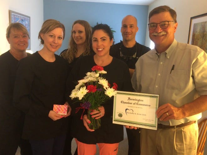 The Farmington Chamber of Commerce awards its Business of the Month Award for July 2021 to Dr. Richard Bush and his dental office. Pictured, from left, are Terri McCord, Julia Bentley, Christine Buchanan, Ashley Rothfuss, Dr. Ahmed El-Halaby and Bush.