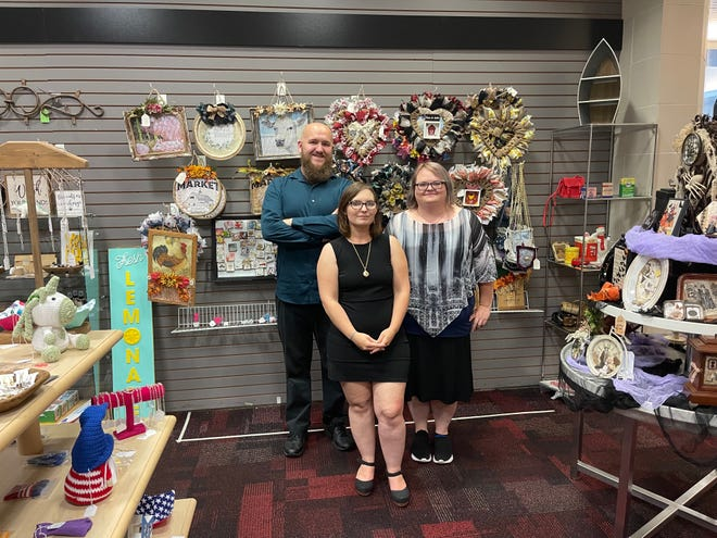 Ann Craig (center) recently opened Flashback Antiques and Crafts at the Mall of Monroe. Mark Jablonicky II (left) and Tanya Craig (right) help Ann manage the store.
