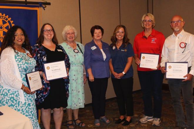 Maria Catron, Mandy Colburn, Elaine Bunick, Debbie Alexander Davis, Tracy Boatner, Teresa Duncan and Todd Bergener receive Paul Harris Fellow certificates.