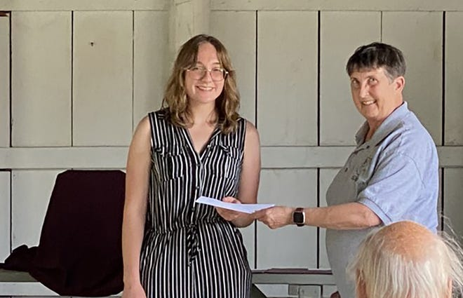 Amy Avolio, left, of Norwich wasrecently awarded the Chenango County Historical Society's annualElinor Robb Troicke Memorial Scholarship by Gail Merian, chair of the CCHS Education Committee.
