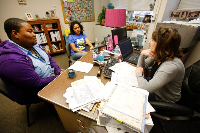 A school counselor works with high school seniors at Northwest Classen High School in 2013. The Oklahoma State Department of Education distributed $35 million in grants to help schools hire more counselors and mental health professionals.