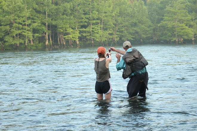 Fishing on the Mountain Fork River brings tourists to the Broken Bow and Hochatown areas.
