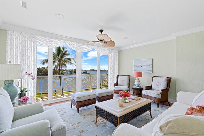 Sliding glass doors in the living room at No. 3E at The Villas, 425 Worth Ave., afford a view of the Lake Worth Lagoon.
