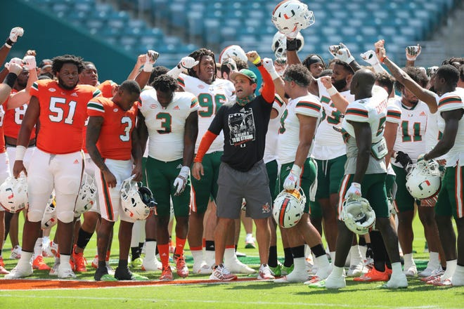 UM football coach Manny Diaz and the players whoop it up during the spring game at Hard Rock Stadium