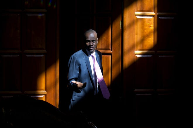 FILE - In this Feb. 7, 2020 file photo, Haitian President Jovenel Moise arrives for an interview at his home in Petion-Ville, a suburb of Port-au-Prince, Haiti. Moise was assassinated in an attack on his private residence early Wednesday, July 7, 2021, and first lady Martine Moise was shot in the overnight attack and hospitalized, according to a statement from the country's interim prime minister.