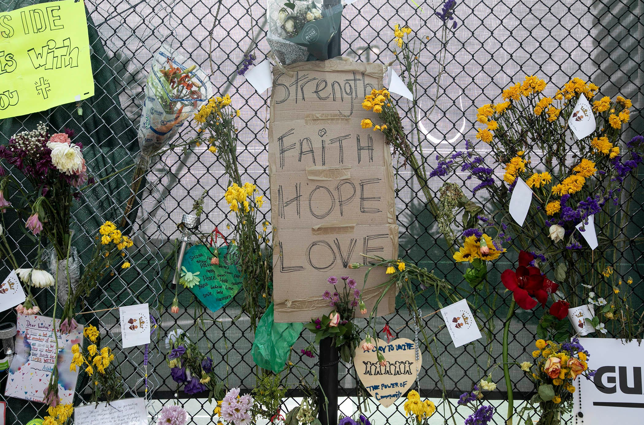 Flowers, signs and notes left in memory of victims of the Champlain Towers South collapse in Surfside, Florida Friday, July 9, 2021.