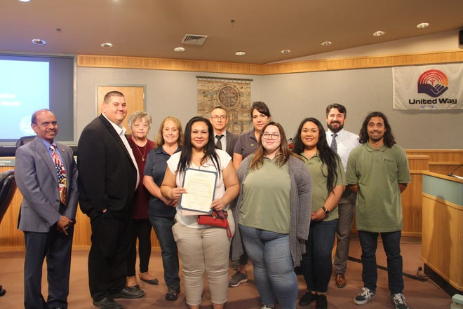 Staff members from the Women's Center -- High Desert, Inc. join Ridgecrest City Council members on July 7, 2021 to declare July 2021 as homelessness awareness month in Ridgecrest.