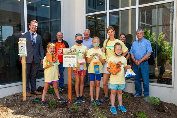 A diversified group of 10 people gathered at the Foundry Art Centre in St. Charles June 18 to plant Missouri native plants in the facility's newly minted native garden, including four members of the Foundry's kids Summer Art Camp.