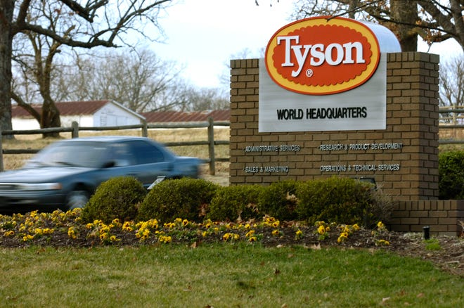 FILE - In this Jan. 29, 2006, file photo, a car passes in front of a Tyson Foods Inc., sign at Tyson headquarters in Springdale, Ark. Tyson Foods is recalling almost 4,500 tons of ready-to-eat chicken products after finding the products may be tainted with listeria bacteria. The U.S. Department of Agriculture announced the recall Thursday, July 8, 2021 after two consumers reported falling ill with listeriosis. AP Photo/April L. Brown, File