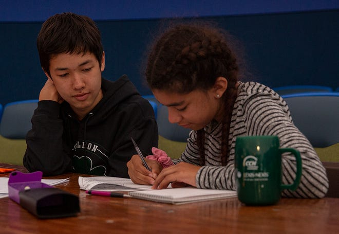 Marcus Koh, left, helps Lula Di Paola in her studies during a session of the African American Student Success tutoring program at the Eugene Science Center. The Eugene Science Center has been facing issues with reopening since the lockdown in 2020. Child care, tutoring and summer camps have helped keep the staff busy and museum alive.
