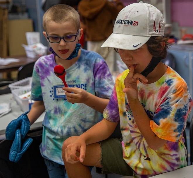 Liam Dasho and Henrik Bowers-Payne enjoy some of their own chocolate as their molds cool off. The Eugene Science Center has been facing issues with reopening since the lockdown in 2020. Child care, tutoring and summer camps have helped keep the staff busy and museum alive.