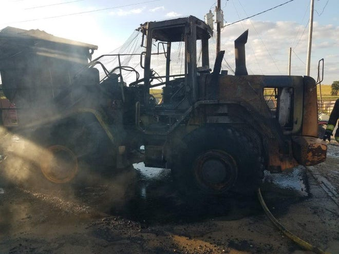 A Caterpillar loader and other vehicles were damaged in a fire in Saline County Wednesday.