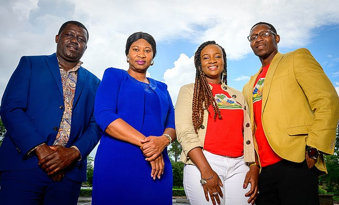 Palm Coast Haitian Association members Escade Mettelus, Marie Erlyne Louis, Daphnee Dorval, and Dr. Jean-Max Dorval stand together in front of the Parkview Baptist Church in Palm Coast before meeting to discuss the assassination of the president of their native country on Friday.