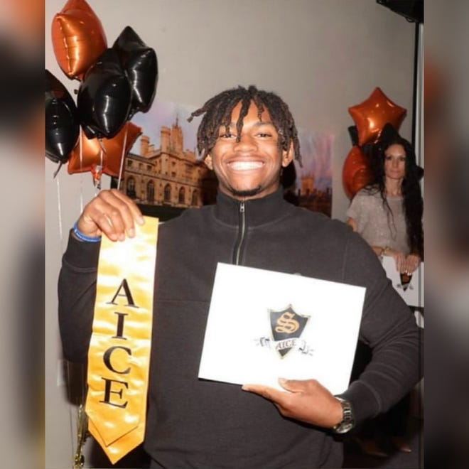 Jalen Smith poses after high school graduation earlier this year. The 18-year-old died in a drowning at Nathan Benderson Park.