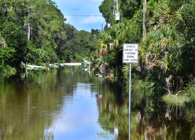 A view down a flooded Lady Slipper Avenue in North Port. Streets near the Mayakkahatchee Creek in North Port were flooded Friday as rain from Hurricane Elsa continues to drain. According to North Port officials, no homes had water in them, but the flooded streets were making access difficult for residents.