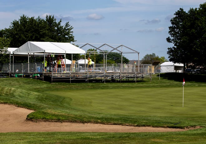 Crews work to setup the spectator stand around the 18th green for the Korn Ferry Tour's Memorial Health Championship presented by LRS golf tournament at Panther Creek Country Club in Springfield, Ill., Friday, July 9, 2021. [Justin L. Fowler/The State Journal-Register]