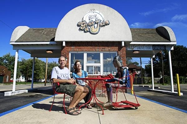 Peter and Meg Lazare, outside the Sixth Street Grab-A-Java in early 2018. The couple would sell the coffee shop later that year. [Jason Johnson/The State Journal-Register]