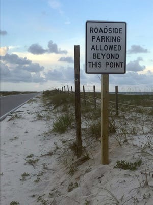 This is one of the new parking signs on Perdido Key Beach Road at Gulf Islands National Seashore in Gulf Breeze.