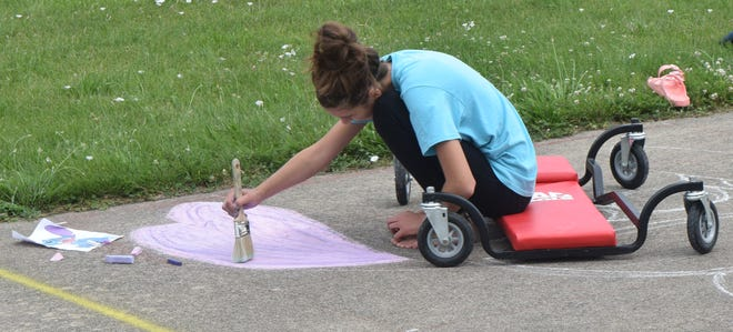 Artists started working Friday morning on chalk-art creations on the former go-kart track west of The Station restaurant.