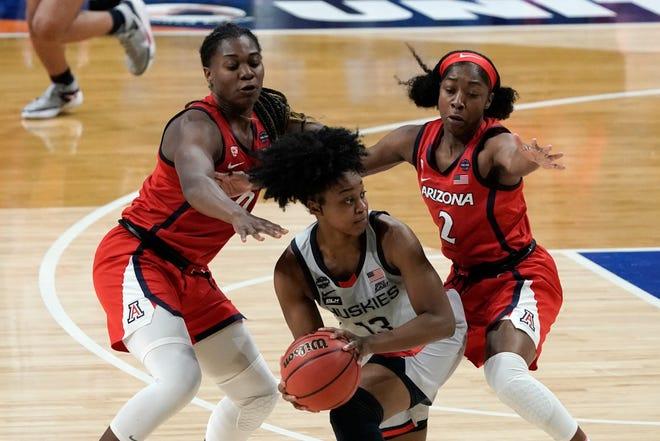 UConn guard Christyn Williams, center, looks to pass around Arizona forward Trinity Baptiste, left, and guard Aari McDonald (2) during the women's Final Four at the Alamodome in San Antonio.