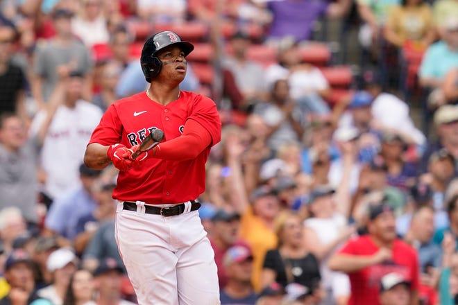 Boston Red Sox's Rafael Devers watches his three-run homer against the Kansas City Royals at Fenway Park.