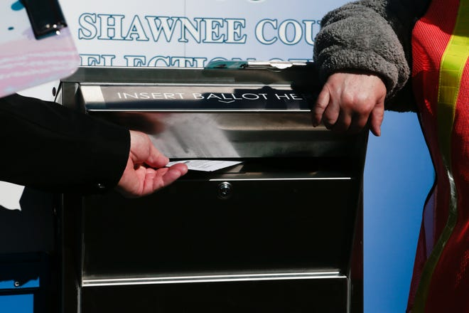 A ballot is dropped off into a secure drop-off box during the general elections in Shawnee County in 2020.