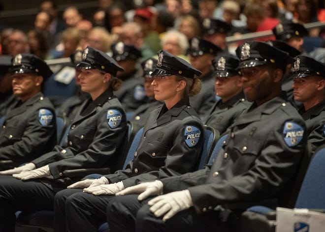 Worcester Police Academy graduates listen to a speech during the Worcester Police Department Class 01-21 graduation at Worcester Tech on Friday.