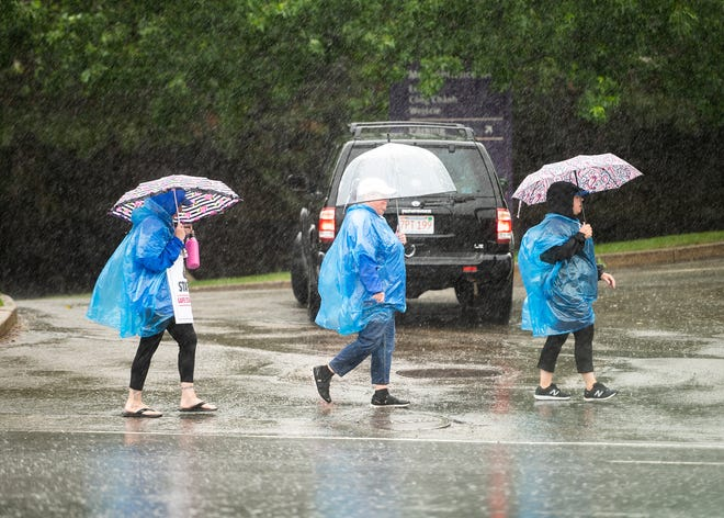 Striking St. Vincent Hospital nurses continued to picket Friday in Worcester as heavy rain poured down during Tropical Storm Elsa.