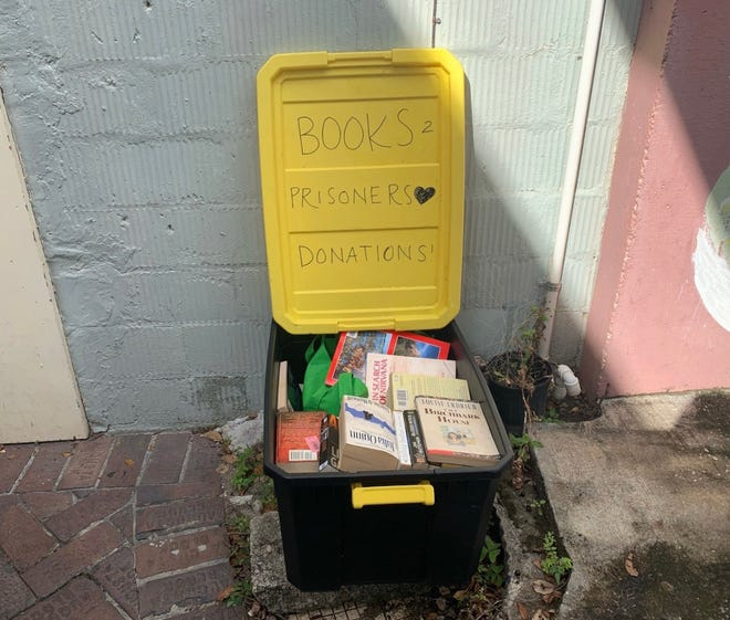 Pictured is a pile of books in the Gainesville Books to Prisoners donation bin outside the Civic Media Center. (Photo courtesy of Gainesville Books to Prisoners)